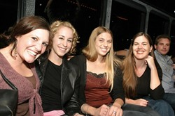 PARTY GIRLS (LEFT TO RIGHT):  Kerry Moore (sales), Lorna Kreutz (Kerry's rommmate), Dora Mountain (production), and Kirsten Blake (sales) get comfy on The Galaxy, the rolling disco party bus from Stardust Limo. - CHRISTOPHER GARDNER