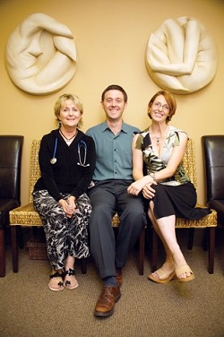 HEALTHY HARMONY:  (Left to right) Nurse practitioner Kathi Fennelly, board-certified OB/GYN Aaron Kromhout, and office manager Victoria Kromhout want to focus on womens health as a whole not just view their patients as a set of reproductive organs. - PHOTO BY JESSE ACOSTA