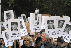 WANTING TO BE HEARD :  Protesters in San Luis Obispo participated in a worldwide demonstration on March 20, the one-year anniversary of the Iraq invasion.