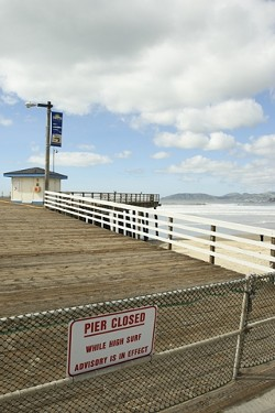 DON'T WALK ON WATER :  Recent heavy swells prompted the closure of the Pismo Beach pier. - PHOTO BY STEVE E. MILLER