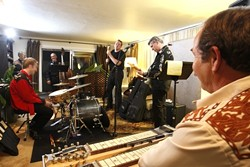 PRACTICE MAKES PERFECT :  The Bangin' 58's work through some songs in singer Paul Brown's living room. - PHOTO BY STEVE E. MILLER