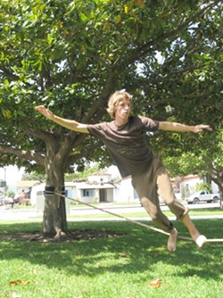 SLACKER :  Jerry Miszewski has been kicked out of just about every city park in San Luis Obispo for slacklining--a sport that's sanctioned in many cities and national parks, including Yosemite, where the sport was born. - PHOTO BY KYLIE MENDONCA