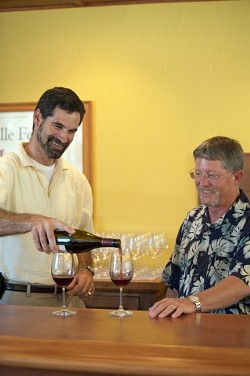 POUR GUYS  :  John Stipicevich (left) and Doug Shaw (right) opened a wine store with a chummy setting and daily tastings, which make for a fun and relaxed atmosphere. - PHOTO BY JESSE ACOSTA