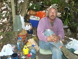 ALONG THE WAY :  While Staff Writer Kai Beech walked along San Luis Obispo Creek, he met Eric Olson, pictured, who left San Diego for the relative safety of San Luis Obispo. - PHOTO BY KAI BEECH
