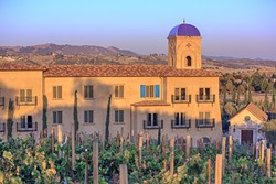 A GROWING INDUSTRY:  A recent study measuring the economic impacts of SLO County's wine industry looks at the economic output from vineyard production to tourism and retail sales. The Allegretto Vineyard Resort (pictured) in east Paso Robles is one of the more recent hotels that's sprouted up with the booming industry. - PHOTO COURTESY OF ALLEGRETTO VINEYARD RESORT