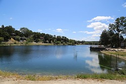 """WHODUNIT?:  A substance believed to be """"pond dye"""" was discharged into Atascadero Lake on April 18, turning the lake bright blue. The color has diminished since, but the California Department of Fish and Wildlife is still investigating who did it and if the solution was toxic. - PHOTO BY DYLAN HONEA-BAUMANN"""