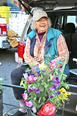 """IN BLOOM:  Ruth """"The Flower Lady"""" Scovell of Orchard to You Farm in Atascadero has been selling at the Downtown SLO Farmers' Market for the past 36 years. - PHOTO BY DYLAN HONEA-BAUMANN"""