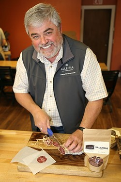 PORK PLATE:  Chef/Owner of Buona Tavola restaurants and Alle-Pia Fine Cured Meats Antonio Varia spices up fragrant, earthy truffle salumi cured at his Atascadero Emporio and processing facility. - PHOTO BY DYLAN HONEA-BAUMANN