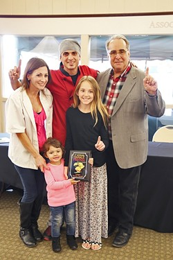 FAMILY FIRST:  The family behind Shave 'N Flav—Steven Sullivan (chef), Brittany Torres (wife), Serenity Sullivan (youngest daughter), Sydney Sullivan (oldest daughter)—accepts their first place award for Judge's Choice award from Atascadero Mayor Tom O' Malley. - PHOTO BY DYLAN HONEA-BAUMANN