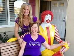 LAUGHTER AND SUPPORT :  Jenny Mulks Wieneke (standing) and Linda Mulks pose with Ronald McDonald at a charity event for the San Luis Obispo-based nonprofit Along Comes Hope. - PHOTO COURTESY OF JENNY MULKS WIENEKE