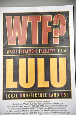 """ACRIMONIOUS ACRONYM:  This color flier printed on 3-by-5 inch cardstock was passed out to residents in the neighborhood near a proposed site for Morro Bay's water reclamation facility, usually called the WRF. Several residents in that neighborhood, who have been giving city officials an earful over the plans, seem to think """"WTF?"""" may be a bit more fitting. - PHOTO BY CAMILLIA LANHAM"""