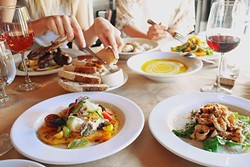 COME TOGETHER:  Kendra Aronson loves photographing big table spreads where friends are sharing good food, like this photo from a meal at Ember in Grover Beach. - IMAGE COURTESY OF KENDRA ARONSON