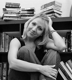 SO MANY BOOKS, SO LITTLE TIME :   Sarah Noffke, a mom and author based in San Luis Obispo, multitasks by writing books on her phone while working out on the treadmill at the gym. Noffke has written 12 young adult fantasy and sci-fi novels in the past several years. - PHOTO COURTESY OF SARAH NOFFKE