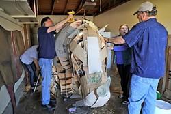 BUILDING A RHINOCEROS:  Local artists Abby Belknap, Creig C. Sherburne, Lucie Ryan, and Larry Le Brane work on building a life-sized rhinoceros. - PHOTO BY DYLAN HONEA-BAUMANN