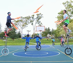 AN ARMY OF ONE (WHEELERS):  The duo Something Ridiculous, which is made up of VonJon and Mark Wilder, juggles on unicycles at Meadow Park while young unicyclists practice. Every Tuesday at 4:30 p.m., Wilder and a few of his teammates from the SLO Ballerz unicycling basketball team set aside some time to teach kids and anyone else who is interested how to unicycle. - PHOTO BY DYLAN HONEA-BAUMANN