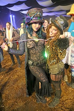 "CELEBRATING SEXY:  Zoe Elliott (right), held by her girlfriend Treanna Dearrillaga (left), says that she feels sexy to be seen by others and hopes people get a kick out of it. ""We just like to add to the experience and just be fucking weirdoes at a festival,"" Dearrillaga said. - PHOTO BY DYLAN HONEA-BAUMANN"