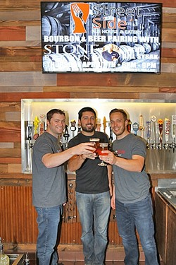 CHEERSING EACH OTHER ON:  From left: Street Side Ale House co-owners Trevor LaSalle, Chris Durkin, and Taylor Reese. Not pictured: fellow co-owner Eric Peterson, who was hard at work creating a back patio for the Atascadero craft beer and comfort food hangout. - PHOTO BY DYLAN HONEA-BAUMANN