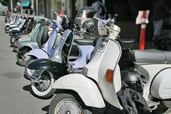 ALL THE PRETTY SCOOTERS:  About 80 scooters participated in this year's annual Rides of March rally, shown here parked on Monterey Street outside Palazzo Guiseppe. - PHOTO BY GLEN STARKEY