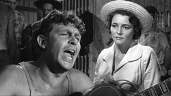 THE DEMAGOGUE BLUE:  Larry Rhodes (Andy Griffith) is discovered by radio producer Marcia Jeffries (Patricia Neal) and given a shot at stardom, but his rise to popularity leads to an inflated ego and abuse of power. - PHOTO COURTESY OF NEWTOWN PRODUCTIONS AND WARNER BROS.