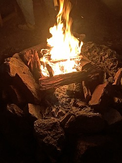 CAVEMAN TV:  No men's gathering would be complete without a campfire. - PHOTO BY GLEN STARKEY