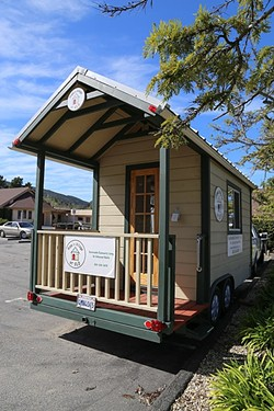 COMMUNITY VILLAGE:  This tiny home on wheels is a mock-up of the structures that Hope's Village wants to someday build into a facility to help homeless people/families transition into a more permanent housing situation. - PHOTO BY DYLAN HONEA-BAUMANN