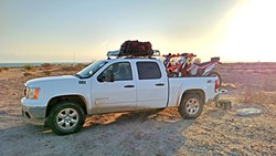 HERE COMES THE CALVARY:  A team of 10 friends and family in five cars served as the team's crew, meeting up with the four riders at various stops for fuel, repairs, and food. - PHOTO COURTESY OF COASTRIDERS POWERSPORTS