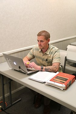 STUDIOUSLY:  Ben Jacobson reviews course materials for a class on criminal procedure at the SLO College of Law, which opened its doors last summer. - PHOTO BY DYLAN HONEA-BAUMANN