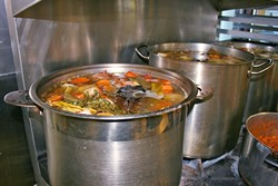 FOUNTAIN OF YOUTH?:  Bones from grass-fed beef simmer for hours alongside nutritious veggies and aromatic spices to create a wholesome (and delicious) elixir. In an effort to keep up with overwhelming demand, The Wellness Kitchen in Templeton is currently looking for more local ranchers to donate or sell leftover bones. - PHOTO BY HAYLEY THOMAS