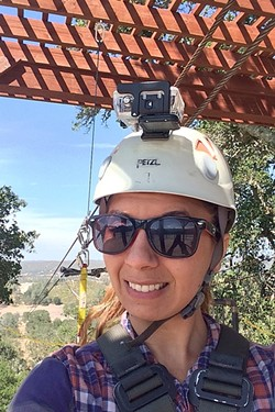 HERE WE GO:  New Times Arts Editor Ryah Cooley prepares to ride the Double Barrel, Margarita Adventure's newest and longest zip line at 2,800 feet. - PHOTO BY RYAH COOLEY