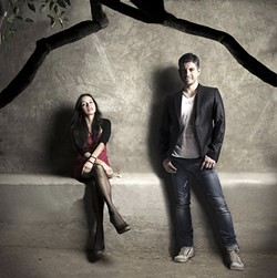 FUMAR CALIENTE :  Smoking hot Mexican acoustic guitar duo Rodrigo y Gabriela makes their Central Coast debut May 27 at the Avila Beach Resort. - PHOTO COURTESY OF RODRIGO Y GABRIELA