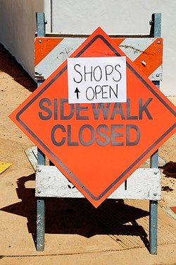 CLOPING:  The shuttered parking lot, closed sidewalks, and construction activity has made things difficult for some of the locally-owned businesses surrounding the Chinatown project on Monterey Street in downtown SLO. - PHOTO BY DYLAN HONEA-BAUMANN
