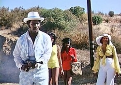 EAT LEAD!:  A pimp named Dolemite (stand-up comic Rudy Ray Moore, left) seeks revenge after being framed and sent to prison in this classic 1975 Blaxploitation film. - PHOTO COURTESY OF VINEGAR SYNDROME