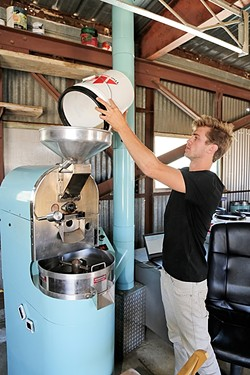 A NEW PARADIGM:  Paradigm Coffee co-founder and Roastmaster Reid Patterson roasts site-specific beans from Costa Rica with a state-of-the-art roaster he purchased from friend and fellow specialty coffee nerd Jonathan Strauf, owner of downtown coffee hub Bello Mundo. - PHOTO BY DYLAN HONNEA-BAUMANN
