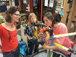 BE A TEACHER:  Kylie Mendonca (left) leads a workshop during Women's Night at the Bike Kitchen while Elisabeth DeSwart (Center) and Emma Patterson (right) practice bike repair techniques. Women's Night takes place every Thursday night at the Bike Kitchen from 6:30 to 8:30 p.m. - PHOTO COURTESY OF BIKE SLO COUNTY
