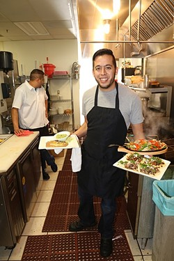 ORDER UP:  Joel Casillas, co-owner of Órale Taqueria in downtown Paso Robles, shows off his serving skills with a range of Mexican delights. - PHOTO BY DYLAN HONEA-BAUMANN