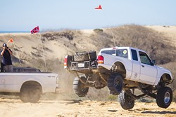 PLAY TIME:  A Ford Ranger completes a small jump off one of the hills at the Oceano Dunes State Vehicular Recreation Area on Jan. 28. - PHOTO BY JAYSON MELLOM