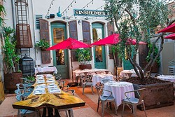 ROOM TO CHEW:  Boasting more than 6,000 square feet, popular Central Coast Italian restaurant Giuseppe's Cucina Rustica now features an ample dining rom, outdoor courtyard, full bar, deli express, and separate garden room for parties and events. - PHOTO BY JAYSON MELLOM