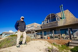 RESIDENT ACTIVIST:  Larry Bross, whose backyard is the Oceano Dunes state park, doesn't want people driving on the strip of beach that runs behind his neighborhood in Oceano. - PHOTO BY JAYSON MELLOM