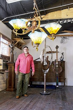 UNDER THE SEA :  Dale Evers' artistic career began with a focus on whales, and sea creatures are still a source of inspiration for him. Evers is pictured here with a recent creation, an octopus lamp. - PHOTO COURTESY OF DALE EVERS STUDIO