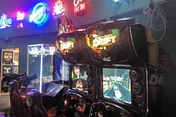 EXTRA LIFE:  With old-style arcades going the way of soda fountains, hunting down classic gaming cabinets is part of the fun. - PHOTO BY CHRIS MCGUINNESS