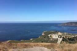 FAR OUT:  The ocean stretches west from the top of Ontario Ridge, with a view of the Avila Beach Pier to the right. - PHOTO BY KAREN GARCIA