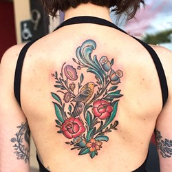 HIDDEN BEAUTY :  The upper back is also a popular spot for tattoos, like this floral design by Jake Schroeder. - PHOTO COURTESY OF JAKE SCHROEDER