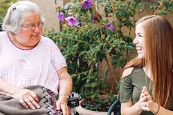 SPECIAL FRIENDSHIP:  Cal Poly student Jaymi Boynton (right) exchanges a laugh with Lorraine Bailey (left), a client with Wilshire Health and Community Services. The two met through the Caring Callers Program, which connects volunteers with homebound seniors seeking companionship. - PHOTO COURTESY OF KELLY DONOHUE