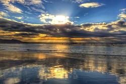 BEACH BEAUTY:  Olde Port Beach faces south, meaning sunrise comes up over Avila Beach pier. - PHOTO BY GLEN STARKEY