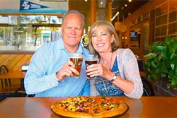 POWER COUPLE :  Jeff and Laura Ambrose built a Woostock's Pizza empire that's flourished in California college towns for 30-plus years (without the help of kale or any other trendy topping). - PHOTO COURTESY OF WOODSTOCKS PIZZA
