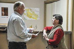 RESIDENT?:  The SLO County District Attorney's Office has filed several felony voter fraud charges against Cal Valley CSD Board President Lisa Marrone, pictured here discussing things with her lawyer Barry Kinman before the Oct. 4 board meeting. - PHOTO BY CAMILLIA LANHAM