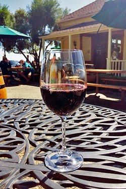 WINE IS FINE:  A glass of Baileyana's Trenza label Obispan red blend goes down easy on a sunny Labor Day weekend. - PHOTO COURTESY OF RYAH COOLEY