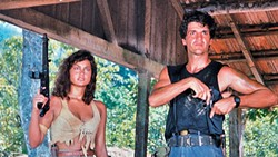 BUNGLE IN THE JUNGLE:  Nazi hunters Nelia (Nelia J. Cozza) and Tonio (Romulo Arantes) search the South American jungles for an evil Nazi doctor in this trashy '80s action film. - PHOTO COURTESY OF INTERNATIONAL SCREEN AND TAT FILMPRODUKTION