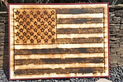'MERICA :  Los Angeles based artist Scott Froschauer creates images using gun powder, like this American flag piece titled 'Old Glory.' - PHOTO COURTESY OF SCOTT FROSCHAUER