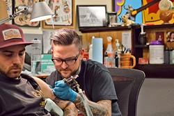 INK ARTIST:  Gary Ellsworth tattoos a client. - PHOTO COURTESY OF GARY ELLSWORTH